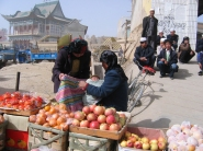 selling fruit while mothering